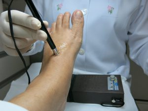 A doctor examining a foot