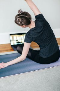 Young woman doing an online yoga class